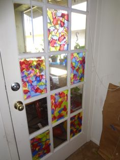 Forgot where I got the idea from but, it's tissue paper made to look like stained glass. You cover the window with Press n' Seal, then use a mix of 1/2 Elmers Glue and 1/2 water and cover the Press n' Seal. Then take pieces of tissue paper and press them to the glue/water mix. Then once it's completely covered with tissue paper, coat it one more time with the glue/water mix to seal it in. Just peel it off when you're tired of looking at it. I did this with my 2 year old.