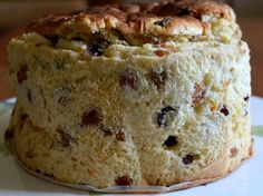 Panettone !! Soft, shreddy, rich, flavorful bread speckled with vanilla seeds, plump rum-soaked raisins and brandy-soaked cranberries.   Last y...