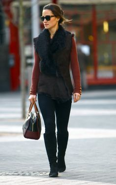 Love the vest and fur stole combination, sunglasses, shirt color, gold buttons at the wrists, and the flat boots.
