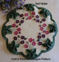 """""""Violets In My Garden"""". PATTERN ,""""Violets in my Garden"""". Wool Penny Rug Candle Mat. The picture shows this made with 100% wool, but wool felt may be substituted for some or all of the wool requirements. 