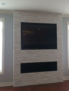 Wondering how to mount a TV over a fireplace without a mantel? We inset a 60 LG TV and three speakers above a fireplace on a stone wall, and surrounded it with a custom frame and speaker grill. Tv Over Fireplace, Linear Fireplace, Home Fireplace, Fireplace Remodel, Living Room With Fireplace, Fireplace Design, Stone Wall With Fireplace, Simple Fireplace, Wall Mount Electric Fireplace