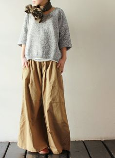 Long baggy trousers, short baggy top, necktie scarf. Natural colours and simple…
