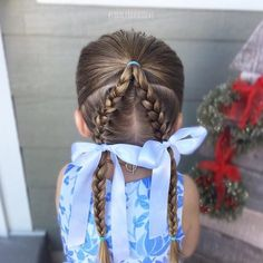 Today I started with the hair pulled half up, then I parted the remaining hair down the center and did 2 french braids!
