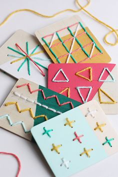 These DIY Dipped Stitching Boards are the perfect boredom-buster! Made with wood boards and bright colors, they will keep little hands busy all winter long!