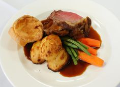 Main: Rare Roast Sirloin of Beef with Yorkshire Pudding, Chateau Potatoes, French Beans, glazed Carrots and Red Wine Jus