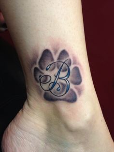 Dog paw print tattoo in honor of my favorite beast of a Dog, Brady ! Tattooed by Kris Patay black heart tattoo studio queens ny