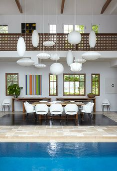 dining room with nelson saucer pendants + a pool! - photographer Marili Forastieri.