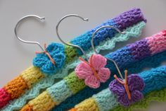 Rainbow crocheted baby coat hangers with butterfly motifs