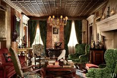 Studio Peregalli ~ LIVING ROOM Facing the living room's 16th-century fireplace are a pair of armchairs dressed in arras tapestry; a 17th-century gilt-wood chandelier hangs above, and an antique Oushak covers the floor.For details see Sources