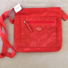 NWT Orange Coach Purse This purse is new with tags never been used. It was a gift but not my style. Perfect condition! Coach Bags Crossbody Bags