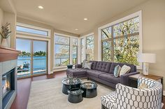Walls of windows provide natural light and a water view. New homes in the Trenton community built by Conner Homes in Kirkland, WA.