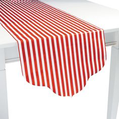 """Red Reversible Table Runner - OrientalTrading.com  17"""" X90"""".  White with red polka dots on reverse.  Paper.  Use over burlap?  $3"""