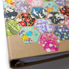 Turn a boring binder into honeycomb hexagon decoupage for your paperwork or planner.