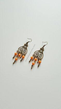 Hey, I found this really awesome Etsy listing at https://www.etsy.com/listing/384820186/orange-boho-earringsdangle-vintage