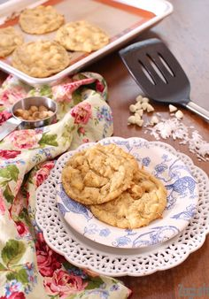 Soft and extra chewy cookies loaded with white chocolate chips, macadamia nuts and coconut. These Tropical White Chocolate Chip Cookies are bursting with citrus flavor - a wonderful small-batch recipe! | ZagLeft