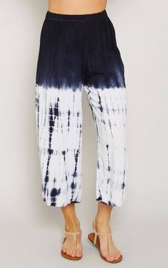 Woven gaucho pants featuring an elastic wasitband. Tie dye print throughout. Flared with single stitching. Unlined. Lightweight.100% RayonHand Wash ColdHand Wash ColdMade in USAModeled in size Small