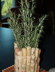 Easy peasy!  A coffee can, glue gun and wine corks.  Start gluing away!