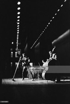 Alfred Wertheimer/Getty Images) American musician (and actor) Elvis Presley (1935 - 1977) performs, with his band, onstage at the Mosque Theater, Richmond, Virginia, June 30, 1956.