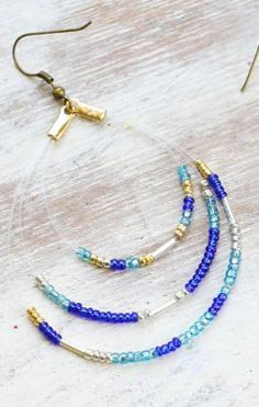 Awesome DIY Seed Bead Earrings www.thesweetestoc… DIY Seed Bead Earrings www. Diy Seed Bead Earrings, Seed Bead Jewelry, Beaded Earrings, Beaded Jewelry, Handmade Jewelry, Beaded Bracelets, Seed Beads, Peyote Bracelet, Hoop Earrings