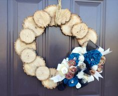 Hubby cut wood disks. I nailed and wood glued them to a flat wood frame then decorated with flowers made from scrapes.