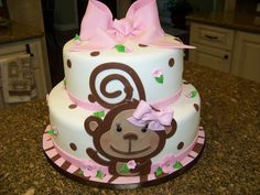 "Monkey Themed Baby Shower Cake For A Baby Girl I was asked to make a cake that incorporated zebra, brown, pink and monkeys for a ""girl..."