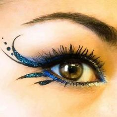 Fantasy/pixie blue-winged, glittery eye makeup. Fantasy makeup
