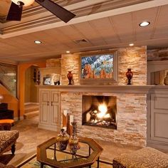 mantel with stone fireplace. oh how I love this stone fireplace! and the enclosed side storage!