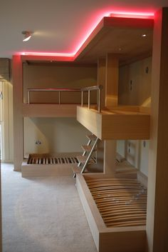Huge bespoke bunk beds in limed oak with integrated lighting & adjustable rope lighting around ceiling