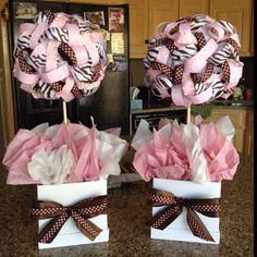 The ribbon center pieces I made for my sisters baby shower!! It's a pink and brown themed shower. <3