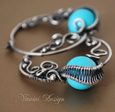 Sleeping Beauty  Fine/sterling silver and turquoise hoop by vanini, $89.00