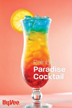 Our layered rainbow cocktail keeps its layers while you sip! Blue Curacao Drinks, Malibu Rum Drinks, Cocktail Drinks, Fun Drinks, Cocktail Recipes, Alcoholic Drinks, Pineapple Rum Drinks, Yummy Drinks, Paradise Cocktail