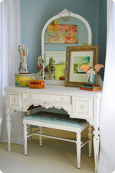 I love this desk/mirror/cabinet with the chair. Instead of a blue damask cushion, it's be black and white.