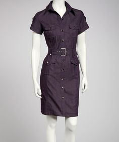 Utilitarian styling brings a modern update to this structured shirt dress. Its sleek silhouette is detailed with front flap pockets, a belted waist and silver-tone hardware.Includes dress and beltMeasurements (size 4): 37'' long from high point of shoulder to hem72% cotton / 26% polyester / 2% spandexMachine wash; hang dryImported