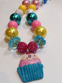 Colorful cup cake necklace pink, turquoise and yellow bubble gum beads with a cup cake pendant