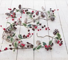 Cone And Red Berry Christmas Garland by The Christmas Home, the perfect gift for Explore more unique gifts in our curated marketplace. Christmas Berries, Diy Christmas Garland, Cosy Christmas, Woodland Christmas, Mini Christmas Tree, Green Christmas, Christmas Home, Handmade Christmas, Christmas Crafts