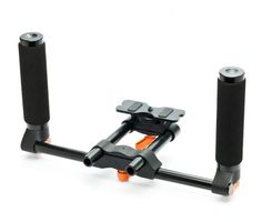 For better balance and more stable, the Hand Held Rig from Seamless is a key item when designing your HDSLR kit. The dual handles of the Hand Held Rig are covered in foam, making it very comfortable to hold. The 15 mm rod design means that this unit is completely expandable. Muslin Backdrops, Photo Folder, Photo Equipment, Camera Accessories, Rigs, Hold On, Key, Design, Wedges