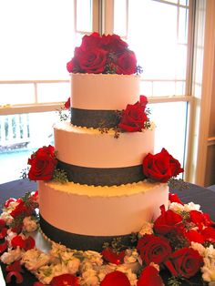 Magpies Bakery Knoxville, TN Custom buttercream wedding cake finished in ribbon and roses.  #wedding #knoxville #tn #ido #custom #buttercream #ribbon #roses #black #red #blackandred
