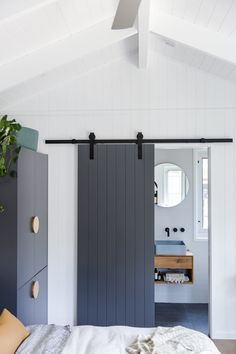 Minimalistic Scandinavian luxury is transformed through navy timber juxtaposed against crisp white and Meir matte black tapware in this project by Build: Photography: Porta Diy, Tiny House, Cottage House, Sliding Door Design, Barn Door Designs, Home Reno, House And Home Magazine, House Plans, New Homes