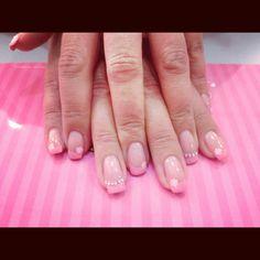 Pink gel nails with swarovski crystals