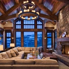 Tour this picturesque ski chalet with stunning warm and cozy interiors in Big Sky, Montana.