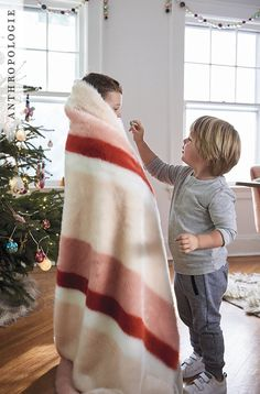 Striped Faux Fur Throw Blanket is for sharing | Shop Anthropologie holiday decor