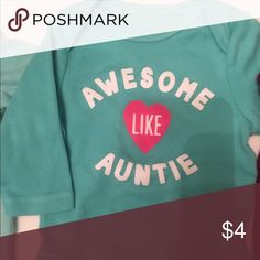 """""""Awesome"""" bodysuit Light blue long sleeve onesie says """"awesome like auntie"""" with a pink heart. Only flaw is a tiny pink ink dot inside collar as shown in pic. Old Navy One Pieces Bodysuits"""