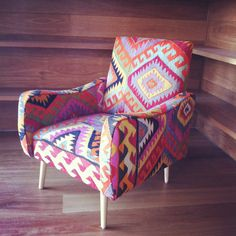 Chair upholstered in a kilim rug. @absolutely beautiful things: News & Stuff