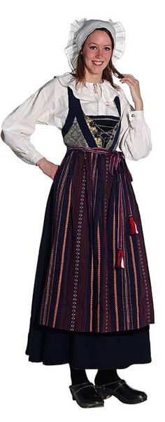Traditional costume of women in Sweden . They wear a long dress , white shirt and a headband .