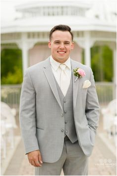 1195a008d69 Groom in light gray tuxedo with ivory shirt and tie.