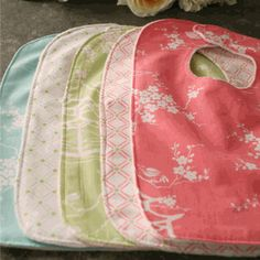 reversible fabric bibs have a pretty pattern on both sides