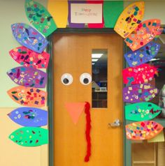 Preschool Wonders: Turkey Time! Each student decorates a feather. You just add giant eyes, nose, etc. Fun idea for class door.