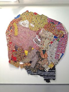 Visionary artist el anatsui fashions these breathtaking creations from cans, bottle caps and neck foils from whiskey bottles