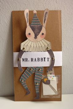 Mr. Rabbit - articulated paper doll set with 8 mini gold brads. $9.99, via Etsy.
