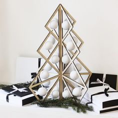Tree24 wooden advent calendar with white balls